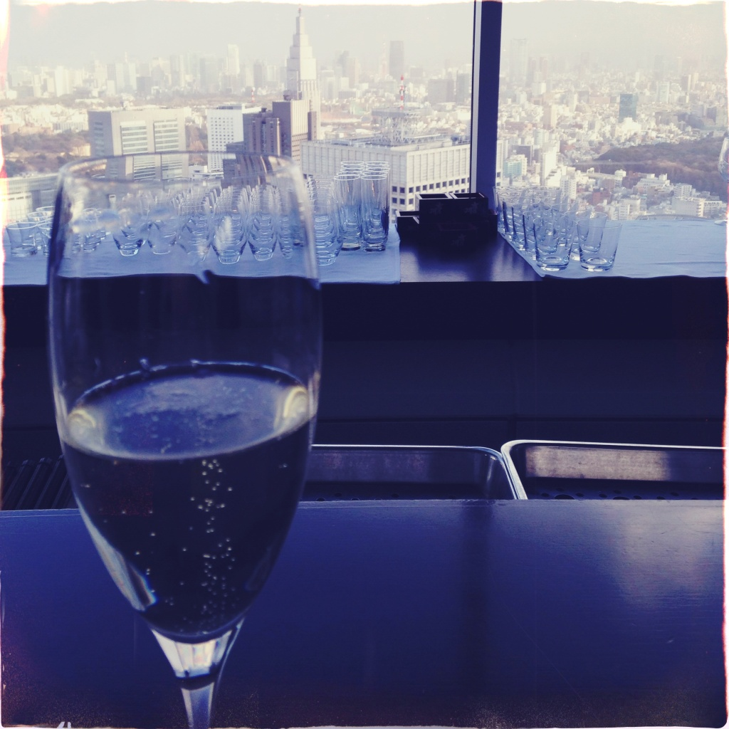 Sparkling wine glass and a view of central Shinjuku.