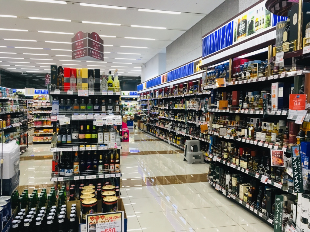 A liquor store, Cave de Yamaya, in Shibuya. Shelves are lined with various spirits and alcohol.